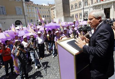 AP - Robert Torricelli, a former United States senator from New Jersey, addresses supporters in Rome in front of the Italian Parliament, Wednesday, July 6, 2011. The majority members of the Italian Parliament declared their support for residents of Ashraf, where 3,400 Iranian dissidents are located in Iraq, and condemned the massacre by Iraqi forces of Ashraf residents last April 8. (AP Photo/Andrew Medichini)