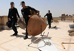 File photo: Police round up satellite dishes in Karaj