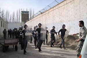 Anti-riot prison guards maneuvering in a prison in Iran