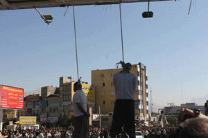 Two hanged in public in Kermanshah by a bus driving away as two men stood on it with ropes around their necks fixed to a bridge, Kermanshah, Iran, August 7, 2014.