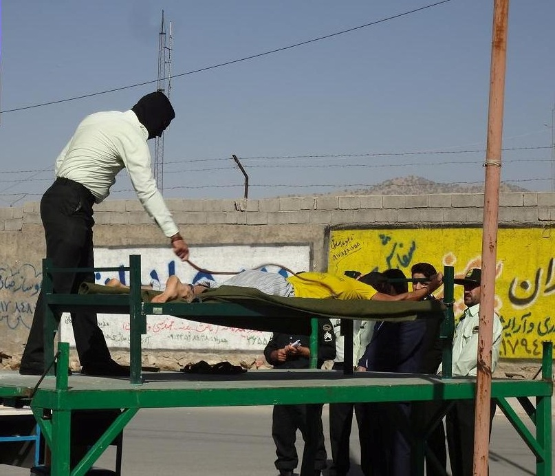 Man being lashed in public in Iran, August 7, 2014