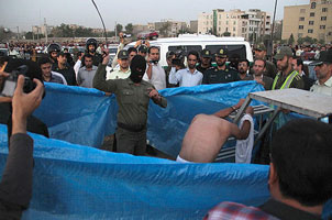 A man being lashed in public in Iran before being hanged, August 6, 2014.