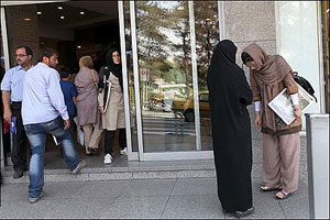 Police fine a woman for wearing sandals in Iran.