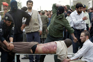 A man is being lashed in public in Iran, 2007