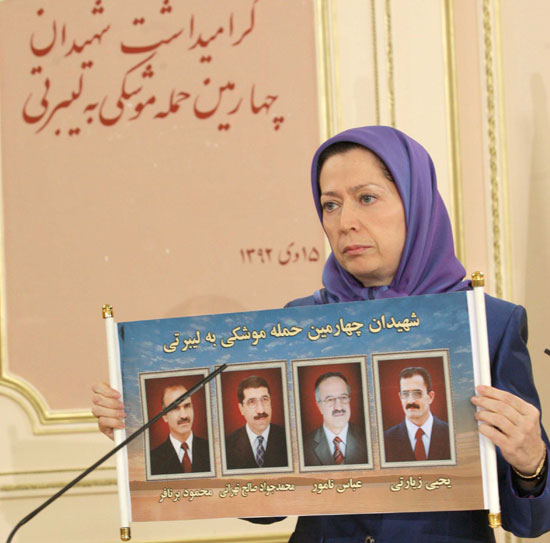 Maryam Rajavi, President-elect of the Iranian Resistance holds photos of four PMOI (MEK) members  killed in December 26, 2014 missile attack on Camp Liberty, Iraq.