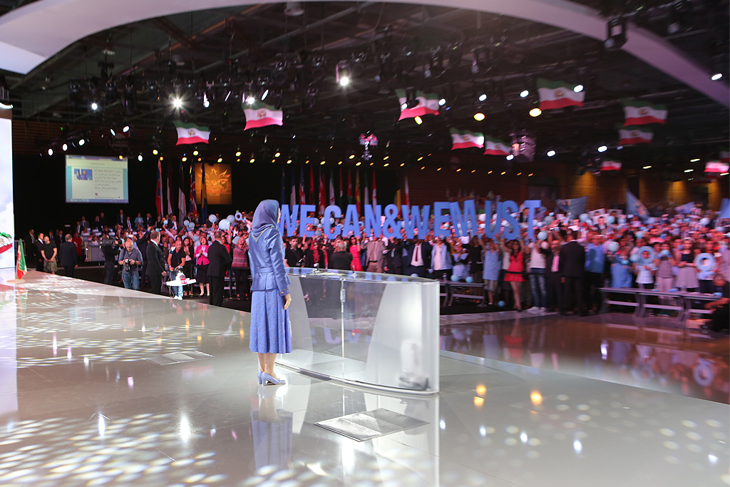 Top Iranian opposition leader Maryam Rajavi is cheered by supporters during mass rally for democratic change in Iran in Parc des Expositions exhibition center on June 13, 2015 in Villepinte