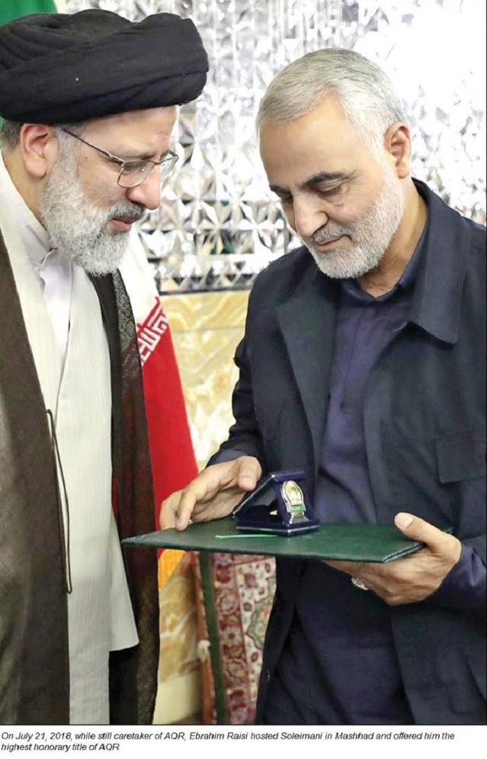 Ebrahim Raisi, the then caretaker of AQR, offers Qassem Soleimani, commander of terrorist Quds Force, the highest honorary title of AQR, July 21, 2018, Mashhad, Iran