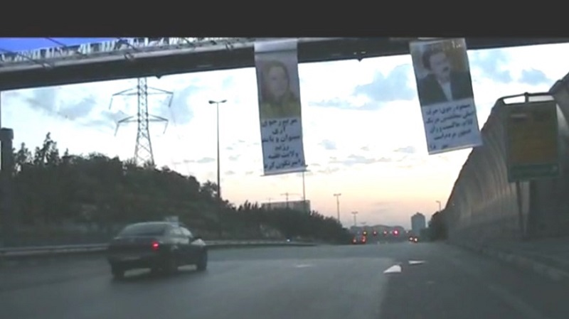 Tehran-Gisha District, Hakim Highway- Resistance Units hand banners of Massoud and Maryam Rajavi from Highway pass overs