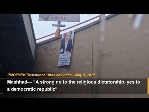 MEK Resistance Units call for Iran election boycott by installing a large banner of Massoud Rajavi