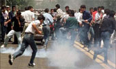 Young people clash with police in Iran's oil rich provincial capital