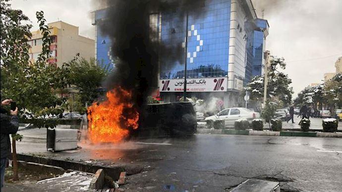 Police car burned down in Iranian uprising in 2019