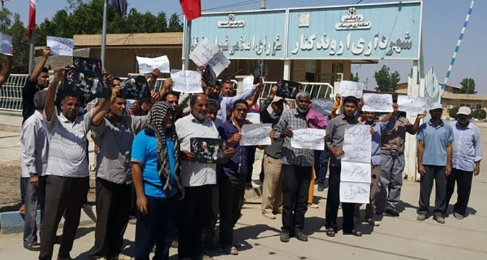 The municipal workers in the city of Arvand Kenar, hold a protest