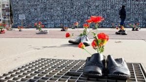 Families and survivors of the 1988 massacre hold an exhibition in front of the United Nations headquarters in Geneva