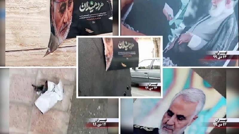 Teheran - Aktivitas pendukung MEK- Teheran - Menghancurkan spanduk dan gambar komandan teroris Pasukan Quds Qassem Soleimani yang dihentikan - 3 Januari 2021