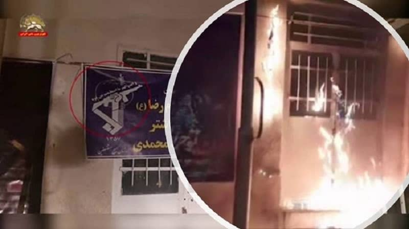Mashhad – Torching the entrance and a large banner installed at the mobilization center for the repressive Revolutionary Guards – January 7, 2021