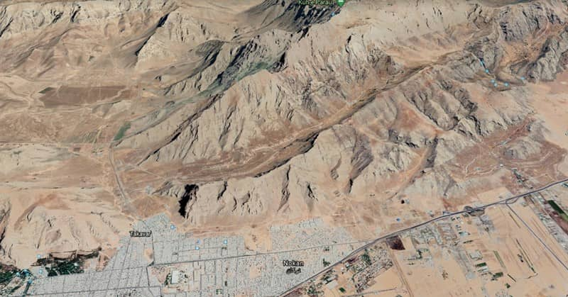 Diagonal satellite images show the missile launch facility, North East of Kermanshah, among the plateaus.