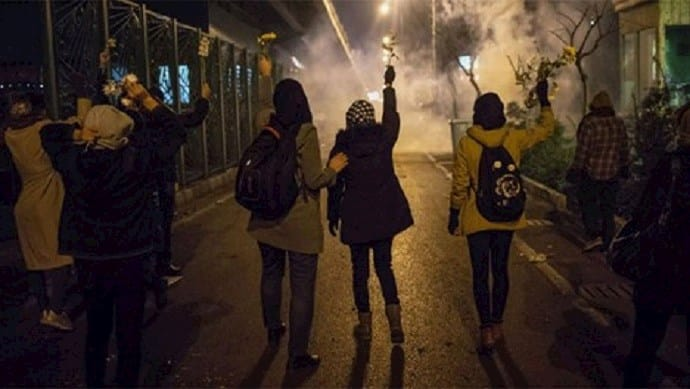 """Young Iranian protesters in Tehran chant """"Down with Khamenei"""" in reference to regime Supreme Leader Ali Khamenei – January 2020"""