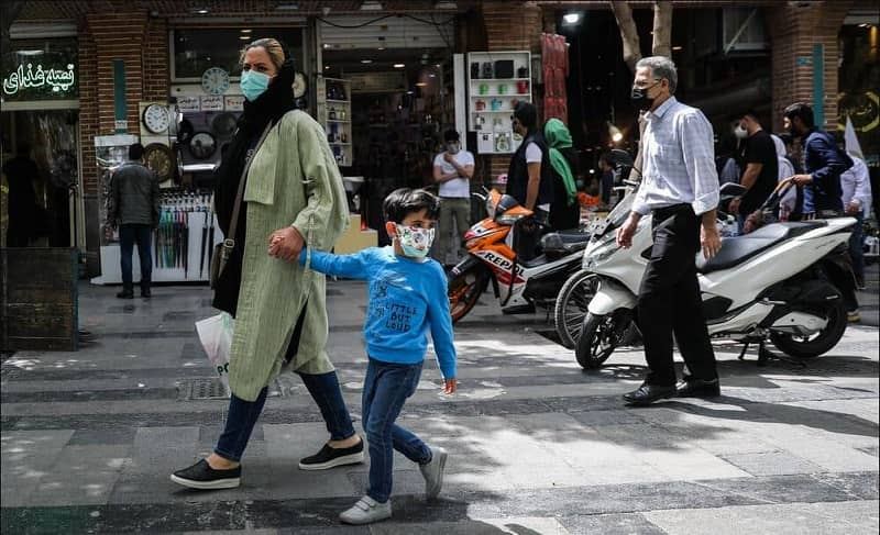 Iranian woman and her son in Tehran