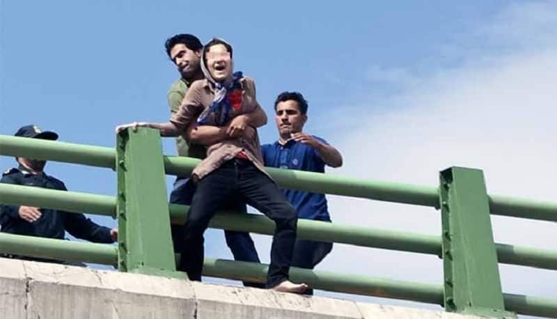 Suicide in Iran, woman jumping-bridge