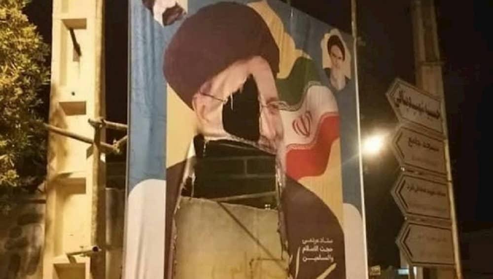 iran-presiden-pemilu-ebrahim-raisi-spanduk-robek