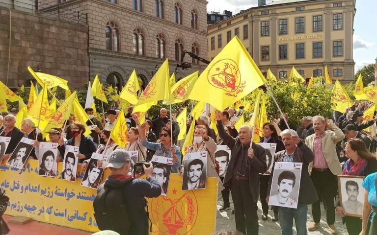 Iranians protest in Stockholm on the 33rd anniversary of the 1988 massacre of political prisoners in Iran