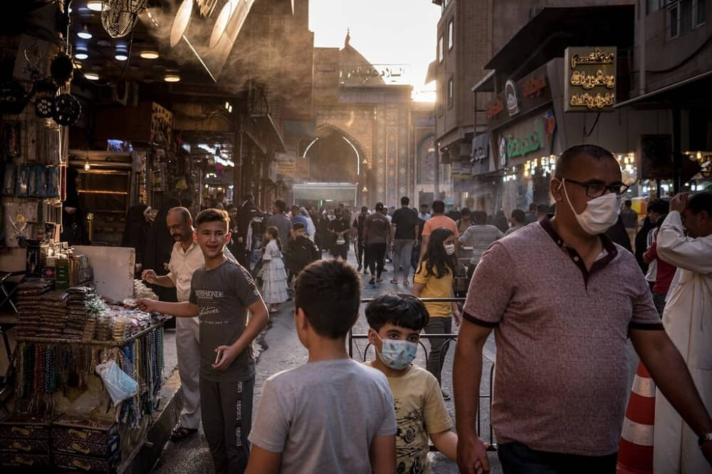 Tourists outside the shrine of Imam Hussein in Karbala, Iraq, in July.Credit...Sergey Ponomarev for The New York Times
