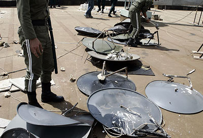 Iranian regime's State Security Forces (SSF) regularly ambush private houses rounding up satellite dishes from the rooftops and back yards.