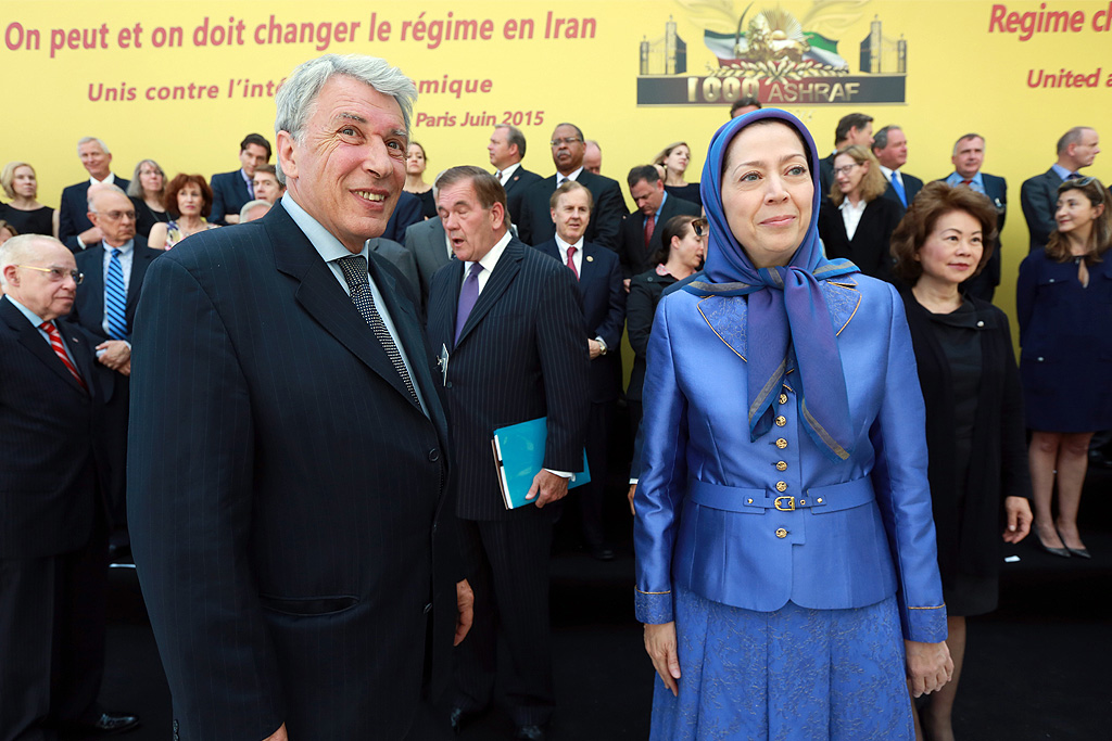 Gilbert Mitterrand, son of the late French President François Mitterrand and head of the human rights group France Libertés, stands alongside Maryam Rajavi, President-elect of the Iranian Resistance