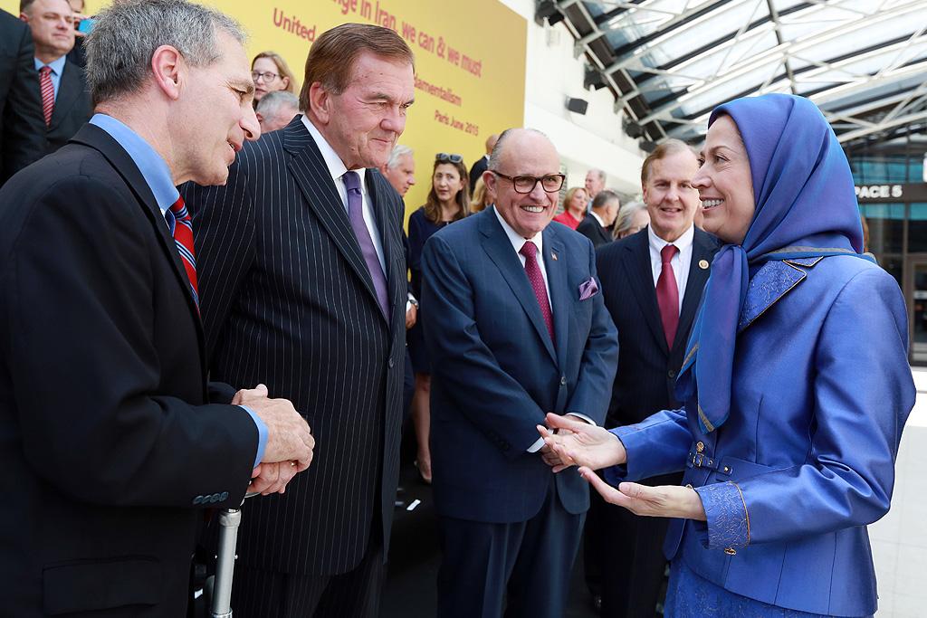 Maryam Rajavi greeting US dignitaries and lawmakers.