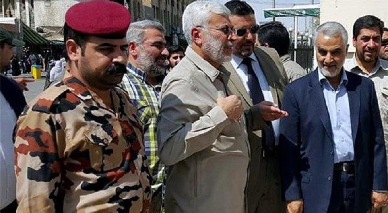 Qassem Soleimani standing with Abu Mahdi al-Muhandis, the commander of the terrorist Iraqi Hashd al-Shaabi