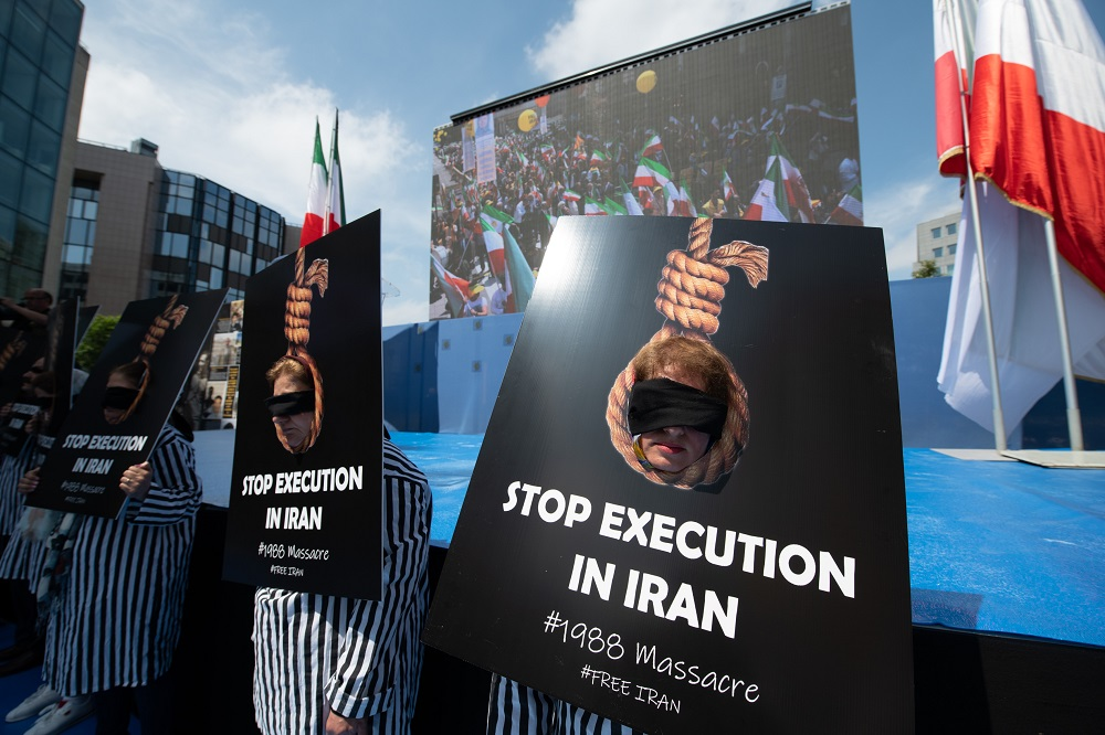 Stop executions in Iran- MEK rally in Brussels, several protesters dressed in prison uniforms call for an end to executions in Iran-Brussels June 15, 2019
